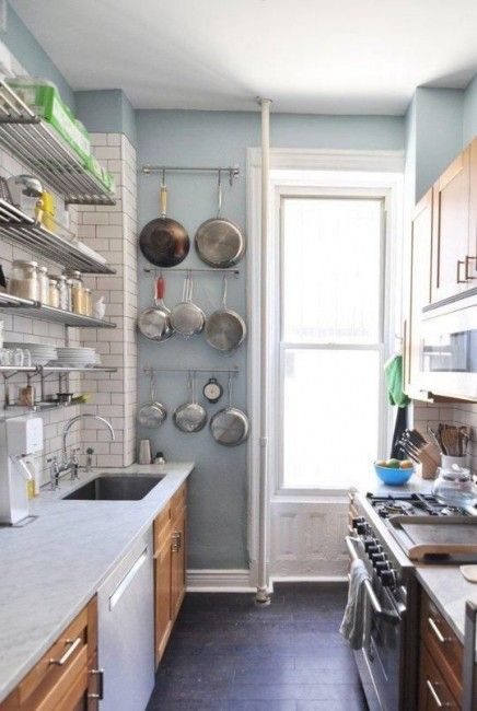 Small Kitchens    Tight, tight, tight with practically no storage but a great level of efficiency with pots and pans hung on the wall for easy accessibility.