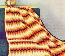 This free crochet afghan pattern is a blast from the past. You'll love the look of the Autumn Chevron Afghan.