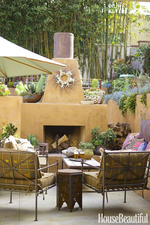 TAMAL – Southwestern flair is mixed into this cozy sitting area — the Mexican lounge chairs are covered in a festive variegated stripe by Donghia with embroidery-like embellishments. Click through for more outdoor fabric ideas.
