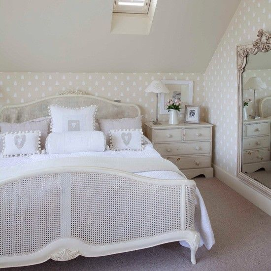 Neutral doesn't have to mean boring. A French-style bed is the perfect central piece for this subtly spotty room, complete with crisp, country-style accessories. An ornate mirror stops it from looking too plain.