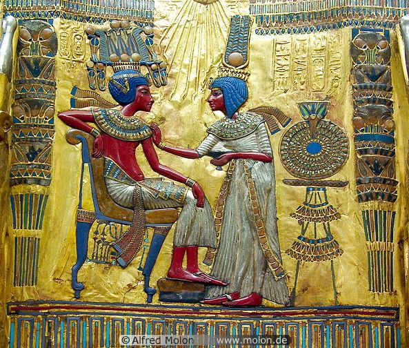 Tutankhamun and his wife, Nefertiti. Gods are often portrayed with blue hair. In Egypt, pharaohs are gods.