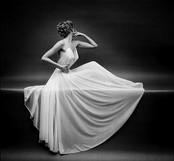 This 1953 award winning advertisement for Vanity Fair is a truly beautiful and elegant. Photographer Mark Shaw does a superb job capturing the models in their flowing gowns.