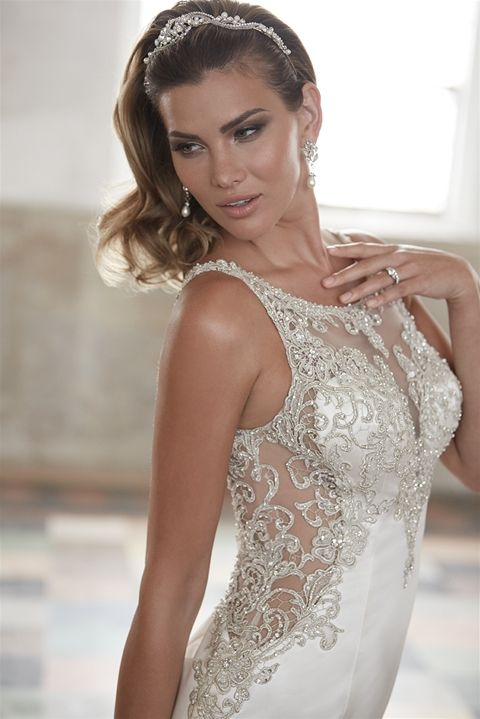 Todays Bride and Formal Wear- Lexington Park MD. Allure Bridals style # 9252. Satin fitted wedding gown with a plunging low back and intricate bead work. This unique wedding gown is the perfect combination between sexy and elegant.