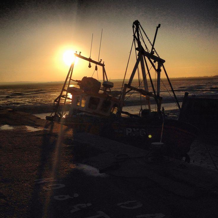 Sunset Behind Docked Fishing Boat