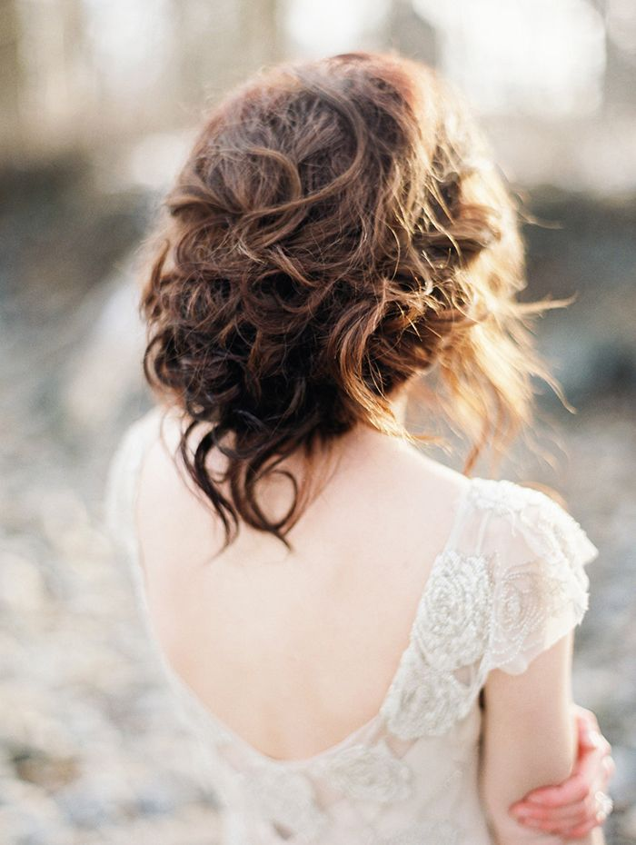 Messy Updo for a Romantic Bridal Hairstyle with a Low Back Wedding Dress  https://heyweddinglady.com/celebrating-rugged-beauty-spring-montana/    #wedding #weddings #weddingideas #styledshoot #weddinginspiration #springwedding #montana #destinationwedding #bridalhairstyle #hairstyle #bride #bridal #weddingdress