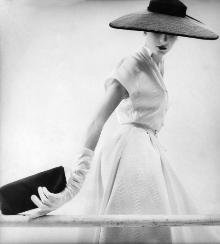 Love the whole look...hat, gloves, clutch...perfection. Fashion shot by John Sadovy, 1950s