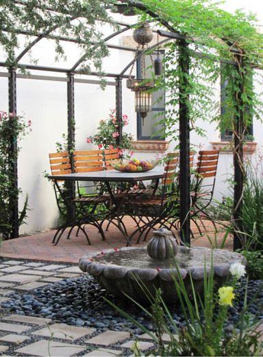 Garden ideas, Landscaping Ideas, arbor, pergola, Metal pergola, mediterranean patio, small space, smal yard, al fresco dining, climbing vines, garden structure, fountain, water feature, Carson Poetzl