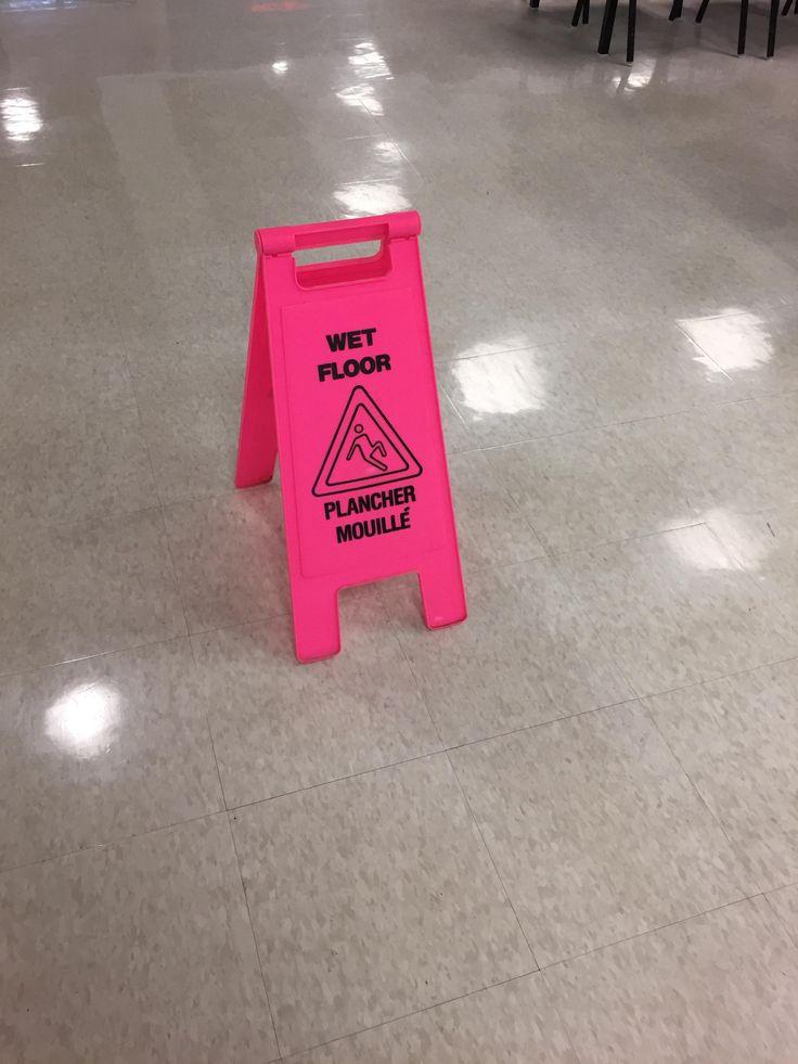 Pink wet floor sign at my school