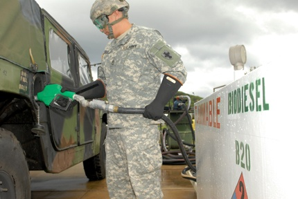 Sgt. 1st Class Juan Silva, Support Operations, 8th Theater Sustainment Command, fills a Humvee with B20, a biodiesel, for the first time, recently. The tactical vehicle is participating in the DoD's Tri-Service Petroleum, Oils and Lubricants Users Group Evaluation. Data from the 8th TSC evaluation and five other B20 evaluation test sites will be compared, later, to determine the future of biodiesel fuel throughout the military.