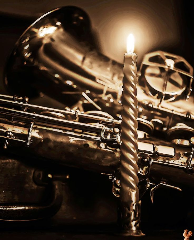 Candle and sax by Giancarlo Gallo