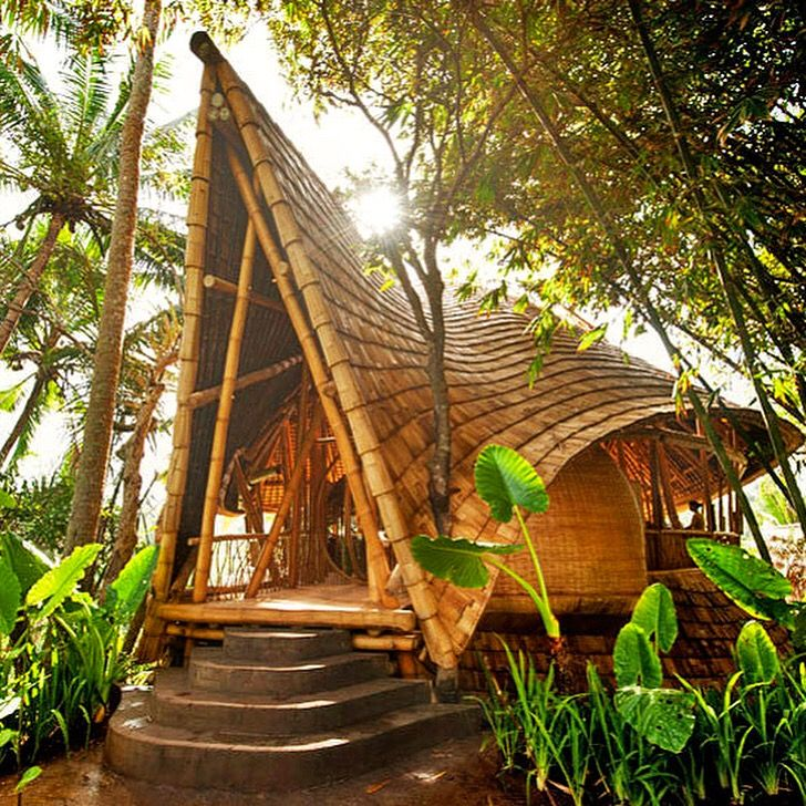 Beautifully designed bamboo houses 🏝, make Bali a must visit destination for everyone who wants to have a fully integrated connection with nature! So... who's booking tickets? ✈️ 😍