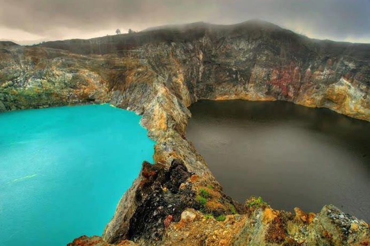 Kelimutu lake in Indonesia-there is also a third lake red in color. These lakes are said to be the gathering places of souls and each color represents different souls...the lakes also change in color-strangely beautiful!!