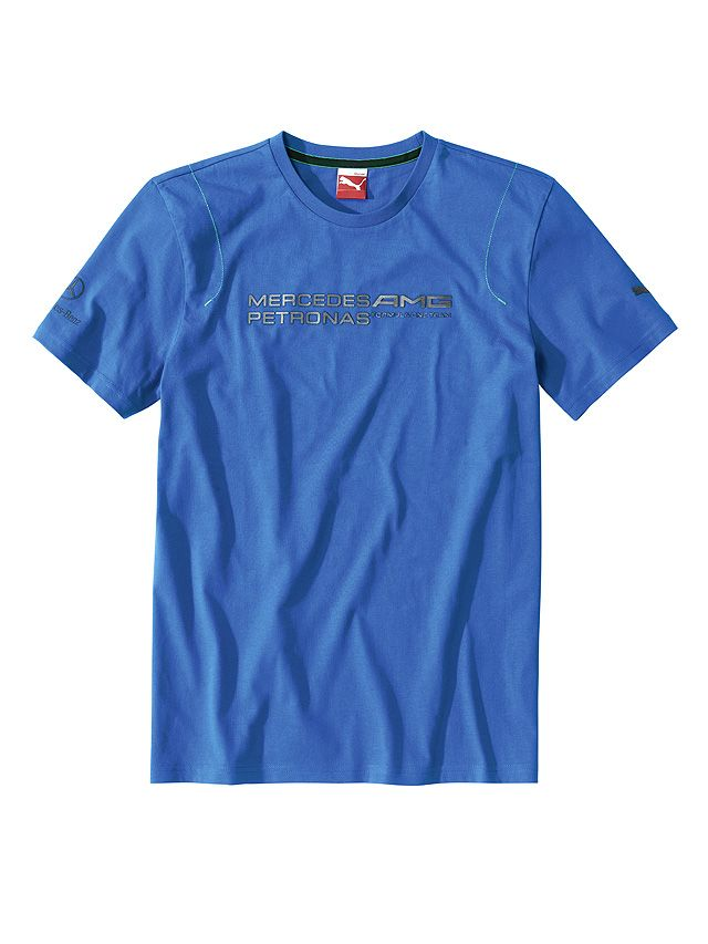 Part number:     B67995238  This blue T-shirt in high-quality single jersey features a raised MERCEDES AMG PETRONAS logo print in graduated silver-grey.  There is Petronas green topstitching on the shoulders and sleeves, a grey Mercedes-Benz logo print and a PUMA Cat logo print.  Colour: blue 100% cotton