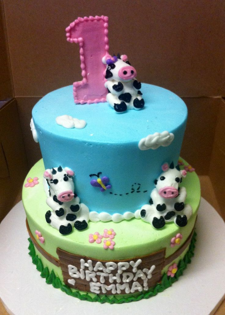 Pink/blue/green colors with cow print -Cow themed first birthday cake