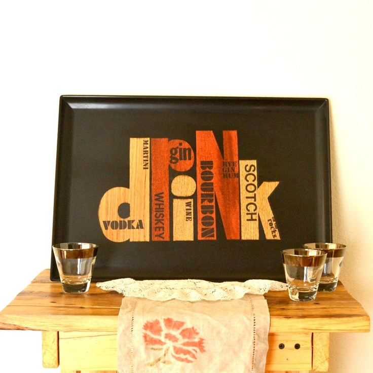 1950s Couroc Drink Large Black Serving Tray Wood Inlay. $34.00, via Etsy.