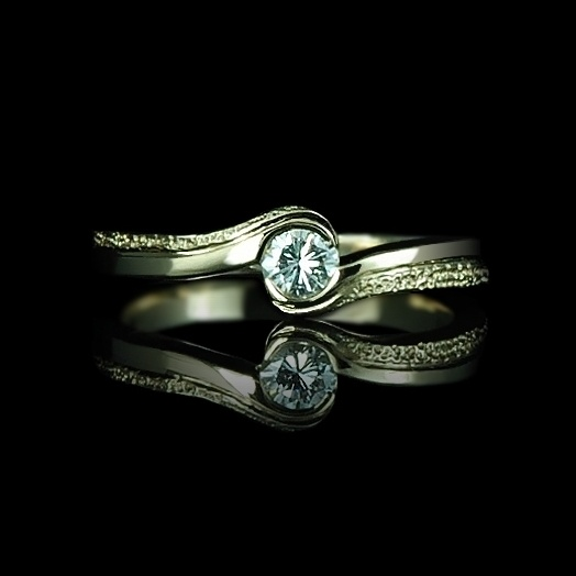 Modern, twisted yellow gold ring with a diamond.