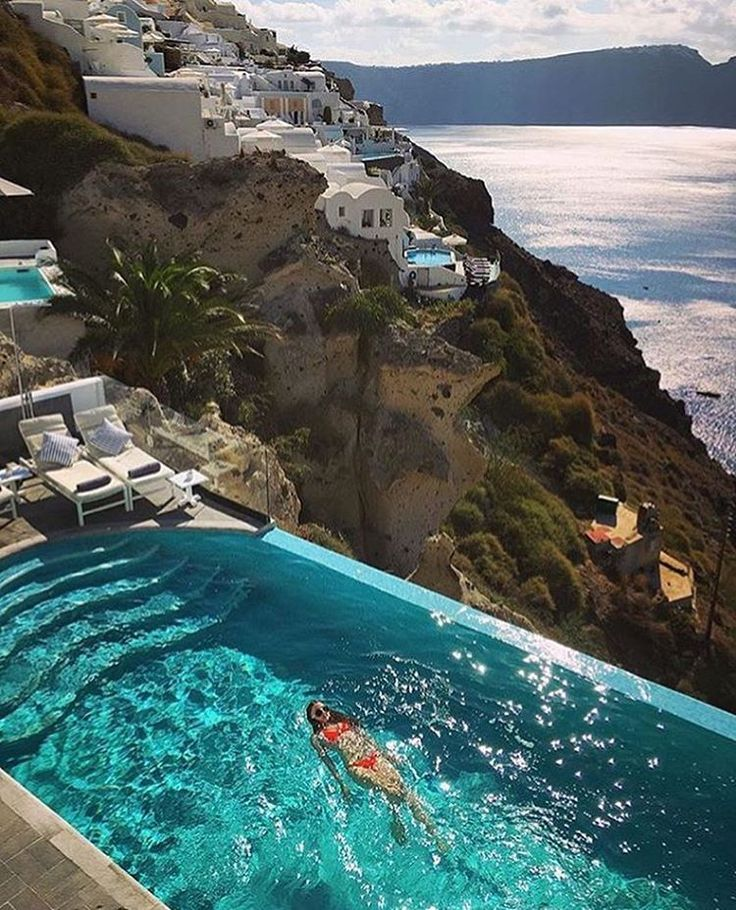 """""""Santorini, Greece. Sit back and enjoy the poolside in this beautiful villa. Would you live here? Tag someone you'd live here with! - Photo by…"""""""