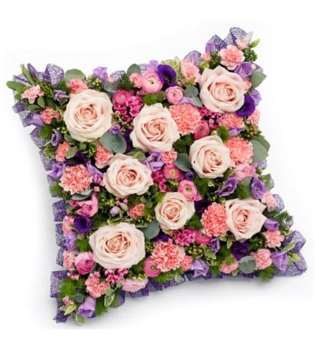 A beautiful pink, mauve and purple cushion featuring pink Roses, Ranunculus, Bouvardia and Carnations with lavender and purple Lisianthus.