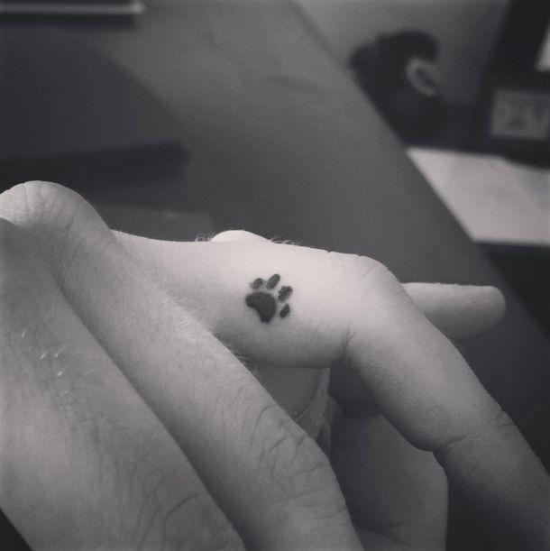 The tiniest little paw print tattoo