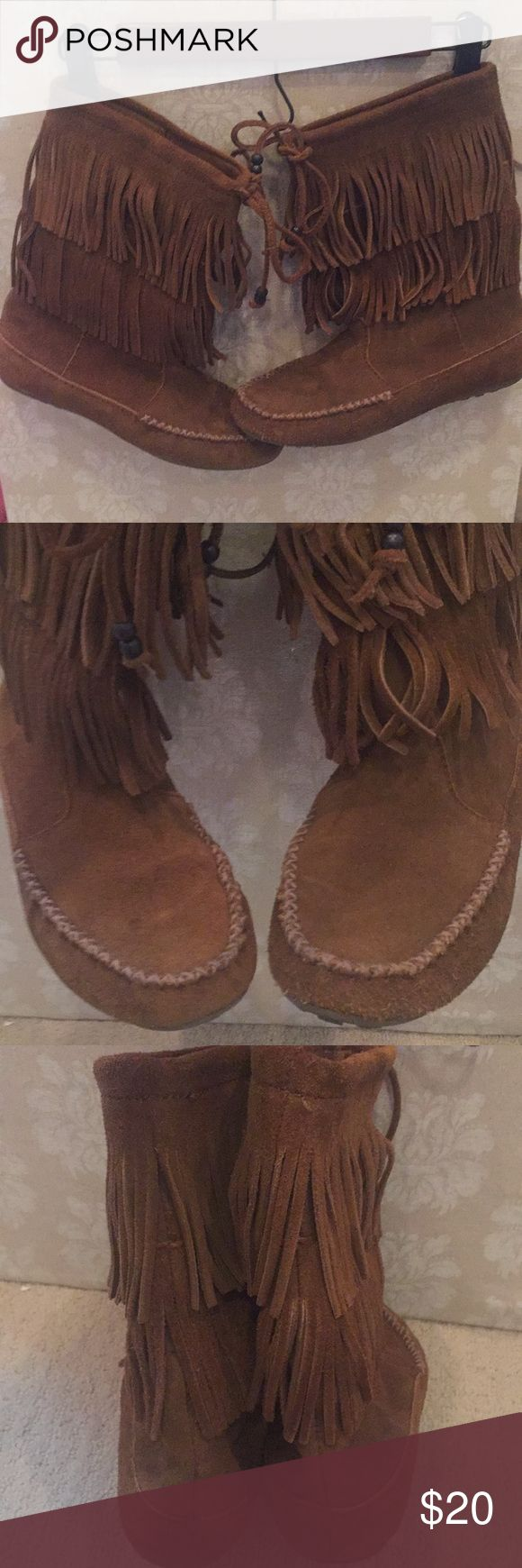 Minnetonka Suede Fringe Booties Genuine leather, super comfortable Booties look great with leggings or skinny jeans!   There's one small, faint spot on the top of the left boot (see last pic), but these are in otherwise awesome condition!  Smoke-free, pet friendly home. All items are in a condition I, myself, would be willing to buy. I try to note all flaws, but please review photos carefully for the most accurate description! Minnetonka Shoes Ankle Boots & Booties