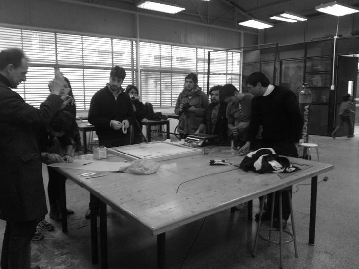 Universidad de Santiago (USACH) students designing and building a seismic platform for evaluating building models.