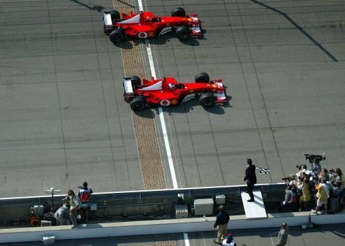 Finish Line advertisement by Scuderia Ferrari  : Rubens Barichello wins against Michael Schumacher by 0.011 seconds in the 2002 US F1 GP