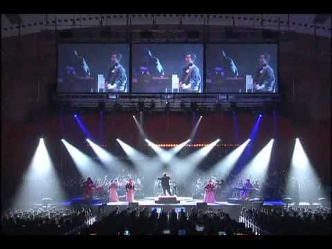 One Winged Angel (Katayoku no Tenshi) by Uematsu Nobuo performed by Uematsu Nobuo and the Prima Vista Philharmonic Orchestra feat. The Black Mages    This was held at the Voices - Music from Final Fantasy concert in Yokohama, Japan on February 18, 2006
