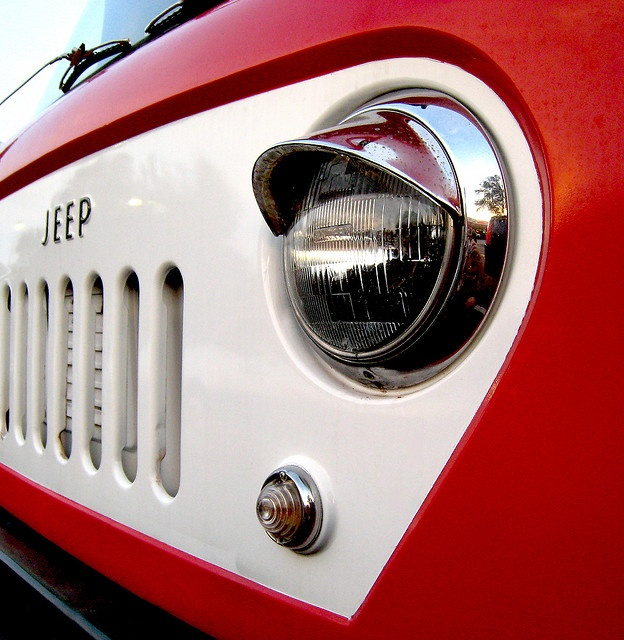 red jeep with headlight cover