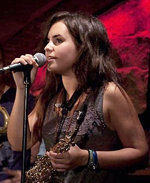 Andrea Motis is a native Catalan speaker from Barcelona, Spain. At fifteen she became the sweetheart of the jazz world as a jazz singer, trumpeter, and saxophonist. www.youtube.com/watch?v=dn_jBLEH87U   www.youtube.com/watch?v=YmKQOqUgFIM