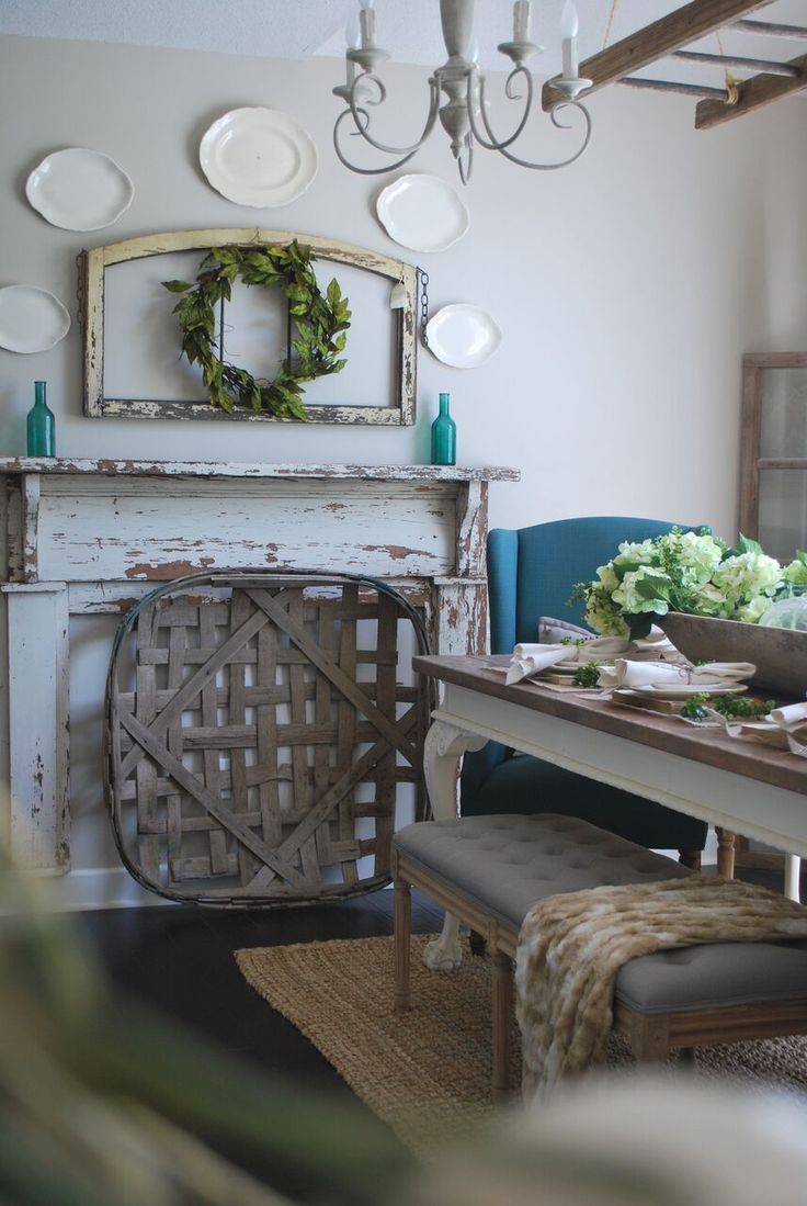 Farmhouse dining room with chippy old mantel