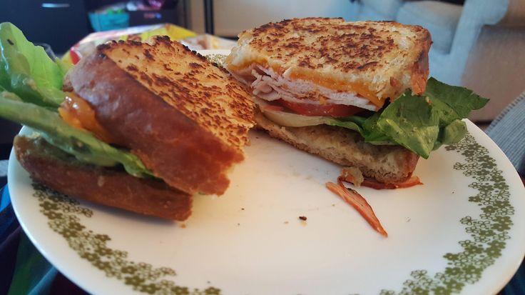 Homemade bread sharp cheddar spicy Boar's Head turkey lettuce tomato and honey m...