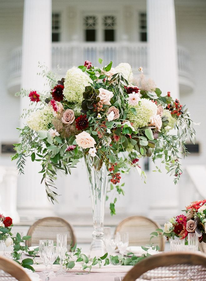 Eucalyptus, olive branch, hydrangea, rose, ranunculus, and dahlia wedding centerpiece: http://www.stylemepretty.com/2016/11/14/formal-southern-elegance-blush-velvet-and-claret-inspiration/ Photography: Studio Elle - http://studioellephoto.com/