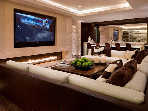 Elegant home Theater Interior Decoration with Large TV Screen Trendy  Fireplace and U Shaped Sectional Sofa.jpg decorating living room with  sectional sofa