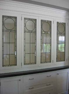 antique leaded glass windows repurposed as kitchen cabinets - Google Search