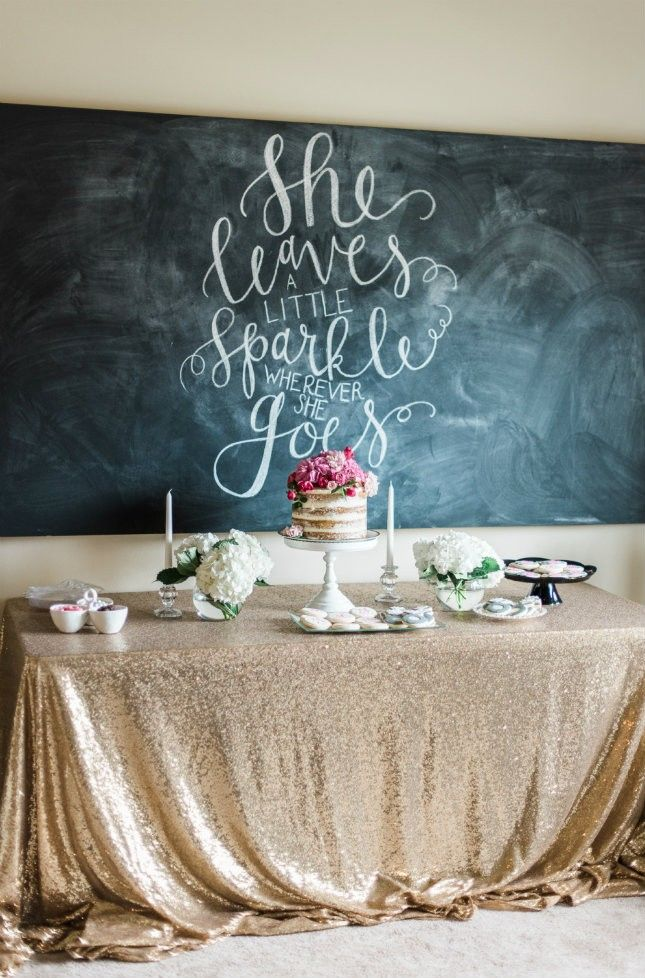 Swooning over this gold-sequined tablecloth + scripted quote in the background of this dessert table.