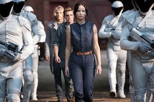 She loves how the Katniss, Haymitch and Peeta are in blues and greys while the peacekeepers are in white.  Not only is it a striking visual piece, but also a great moment defining 'who the real enemy is.'