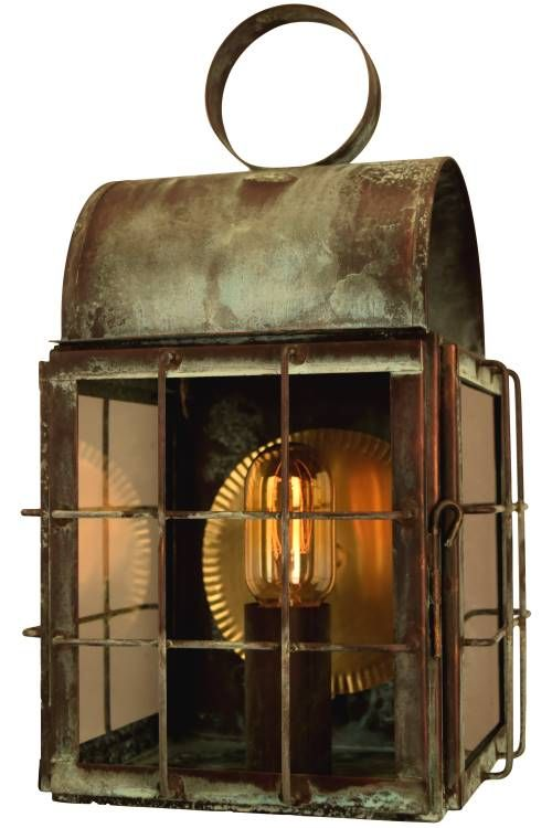 The Back Bay Wall Sconce Copper Lantern, shown here in our classic Verdi Green copper finish with Clear Glass, is a classic nautical style copper lantern perfect for coastal homes, waterfront homes and damp locations like a pier or dock. Handmade in the USA from solid copper or brass the Back Bay Wall Sconce Copper Lantern is guaranteed for life to never rust or corrode.