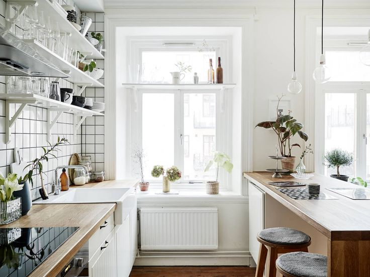 Compact kitchen. Love the white with wood bench tops | interiorjunkie