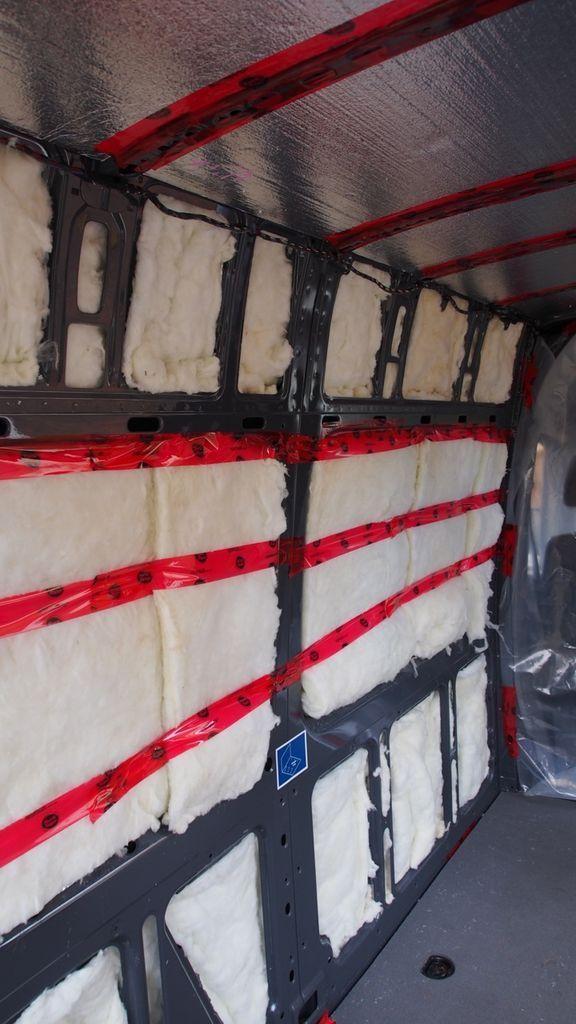 Insulating a camper van using metallic bubble wrap, fiberglass insulation, and a plastic vapor barrier.