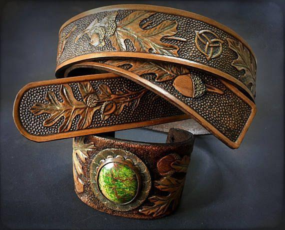 Hand tooled leather belt and cuff with oak leaves and acorns by Gemsplusleather - 234.32EUR#oak #tooledleather #leather #LARP #fantasy #Cosplay #bracelet #cuff #jewelry #jewellery #variscite #elven #druid #cabochon #handmade #art #artisan #leathercraft #carvedleather #gemstones #gems #Gemsforall #GemsPlusLeather #wicca #pagan #jasper #acorn #belt #celtic #celtics #triquetra #celticknot