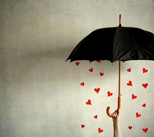 Instead of having them on the wall, hang the hearts from the inside of the umbrella and have an engaged couple stand under it. cute.