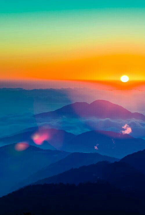 Sunrise over the mountains creating a beautiful ray of colors