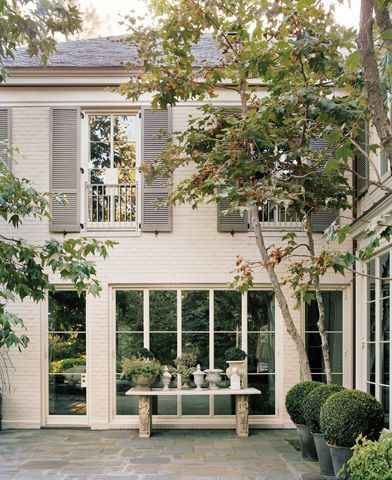 Painted bricks shutters and bricks on pinterest White painted brick exterior