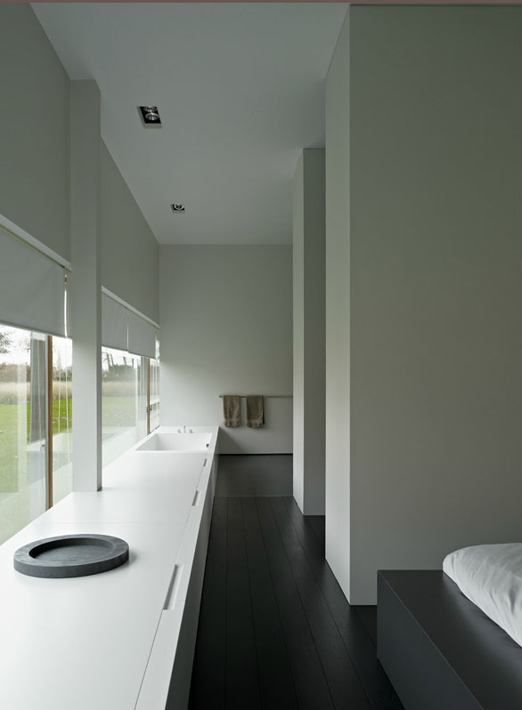 Bedroom - walk-in closet - bathroom combination inside House M. Poperinge by Minus.