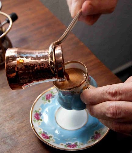 #CyprusCoffee... Fresh finely ground beans brewed in special saucepans known as #mbrikia traditionally made of copper. Sugar is added to coffee and water mixture. Choose #glyko (sweet), #metrio (medium), or #sketo (no sugar). The mixture is heated to dissolve the sugar, then the coffee is boiled until a froth forms which begins to bubble up the pot. Cyprus coffee is served in small cups along with a glass of cold water to drink between sips. Post: Nikki at pissouribay.com.