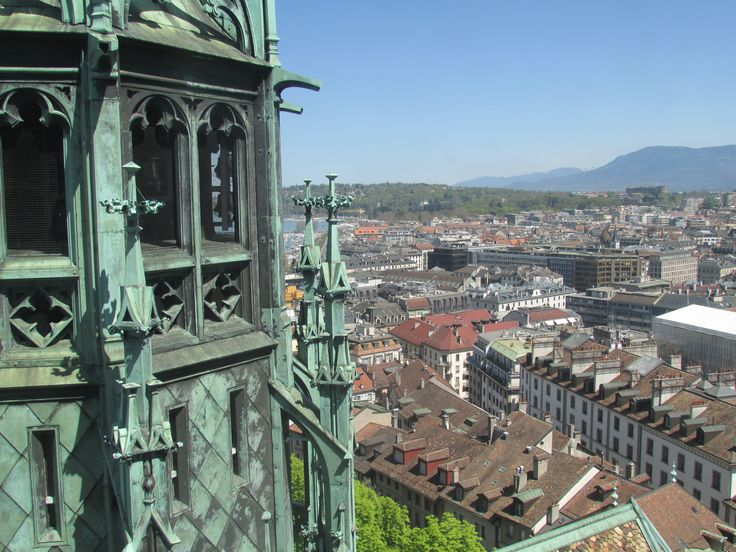 Spire's View -This photo is a great example of what anybody who travels to the top of the St Pierre Cathedral's spire can see. In the photo we see the amazing mountains in the background with the busy city down below