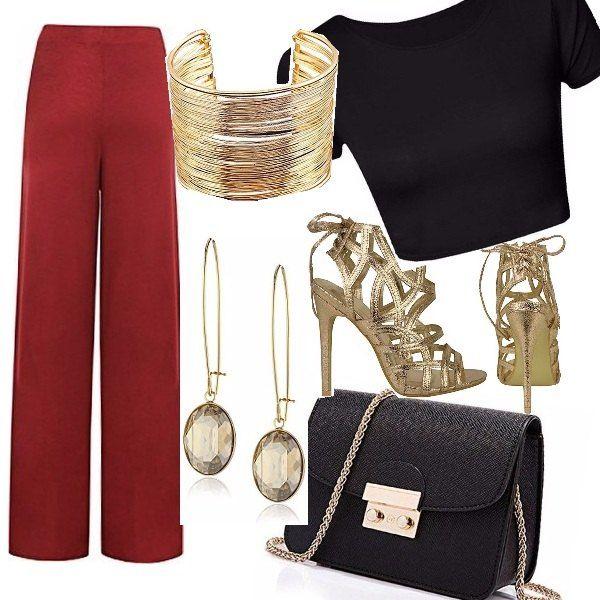 Pantalone ampio colore rosso scuro, top corto nero mini bag con catena oro abbinata ad accessori in tono e scarpe alte con lacci dietro e tacco 11 cm. Look per un aperitivo con amiche o party informale.