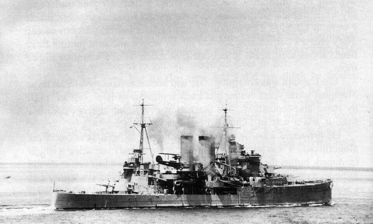 HMS Exeter (68) York-class heavy cruiser of the British Royal Navy, fighting off Japanese aircraft attack during the Battle of the Banka Straits, January 1942.