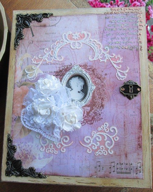 Wooden box, patinated and decorated with scrapbook paper and ornaments...