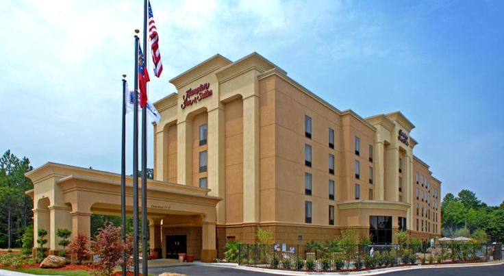 Hampton Inn & Suites Atlanta-Six Flags Lithia Springs This Lithia Springs, Georgia hotel is within a 10-minute drive to Six Flags over Georgia, an amusement park. This hotel offers a gym, continental breakfast and coffee in the lobby.  The Hampton Inn and Suites Atlanta Six Flags has laundry facilities.